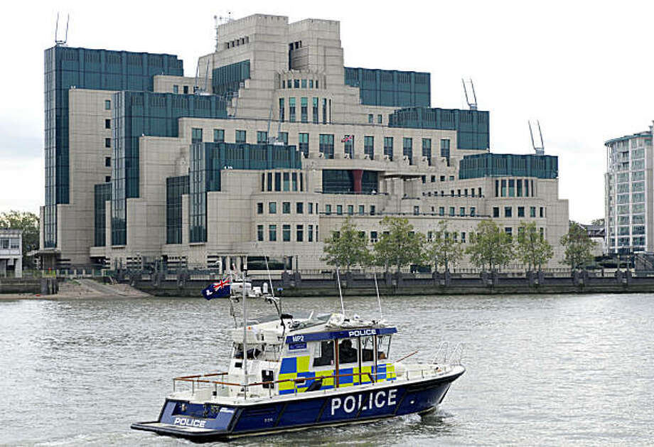 A police boat patrols on the River Thames near the building of British Secret Intelligence Service, SIS, also known as MI6, in London, Monday, Oct. 18, 2010. Britain unveils a package of spending cuts this week,  the harshest since World War II, but counterterrorism and cyber attack prevention are among areas expected to get funding boosts. Terrorism and cyber warfare have been identified as the two most serious threats facing Britain, and a higher priority than preparing for another international military conflict, according to Britain's national security strategy, a detailed plan that will spell out the country's security priorities Monday. Photo: Lennart Preiss, AP