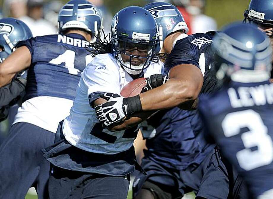 ** CORRECTS MONTH TO OCT. NOT SEPT. ** Seattle Seahawks running back Marshawn Lynch runs with the ball during NFL football practice at the team's practice facility in Renton, Wash., Wednesday, Oct. 6. 2010. Lynch was traded from the Buffalo Bills on Tuesday  for a pair of undisclosed draft picks. Photo: Joe Barrentine, AP