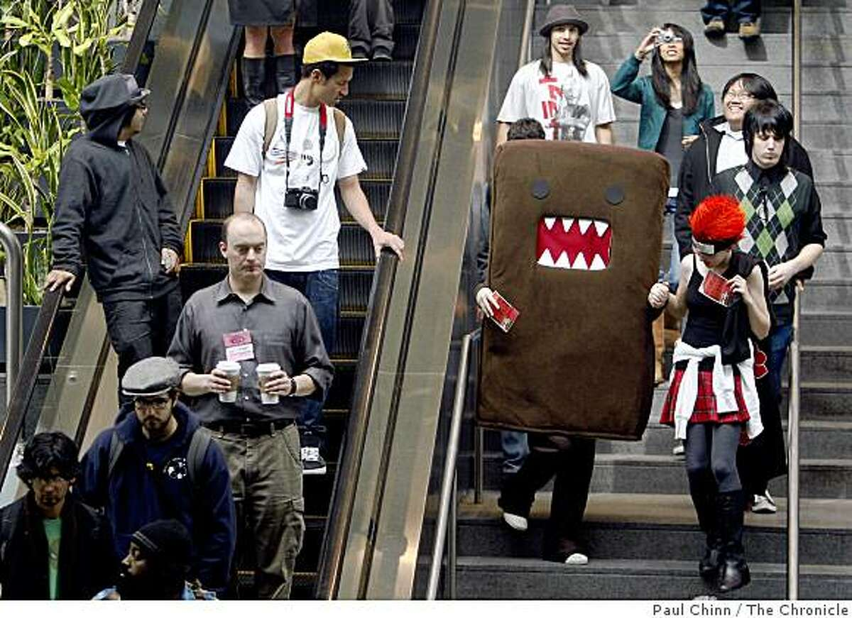Comic book fans of all sorts descend to the WonderCon comic book convention at Moscone Center in San Francisco, Calif., on Saturday, Feb. 28, 2009.