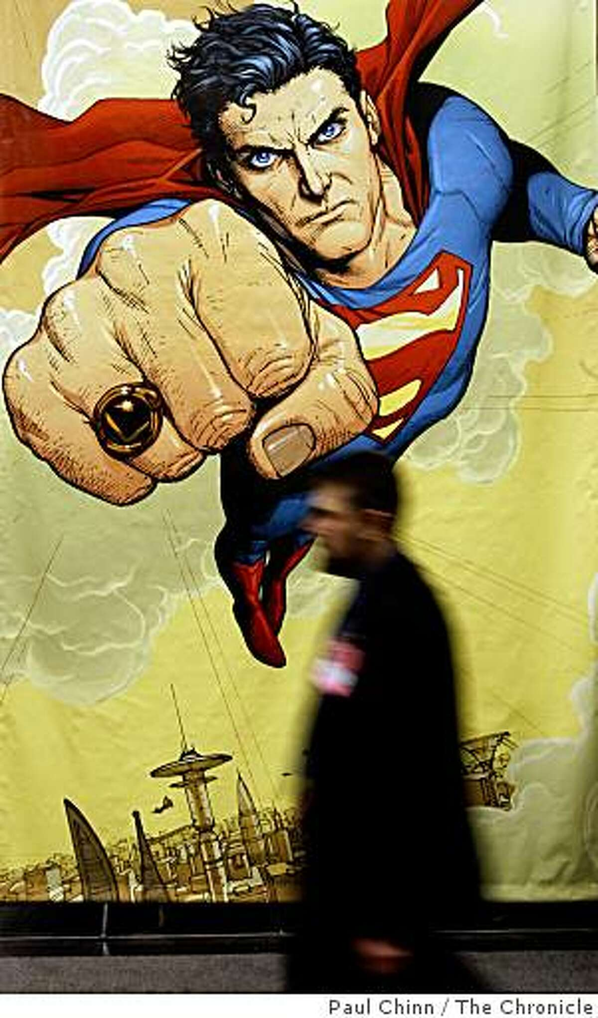 A poster of Superman dwarfs comic book fans at the WonderCon comic book convention in San Francisco, Calif., on Saturday, Feb. 28, 2009.
