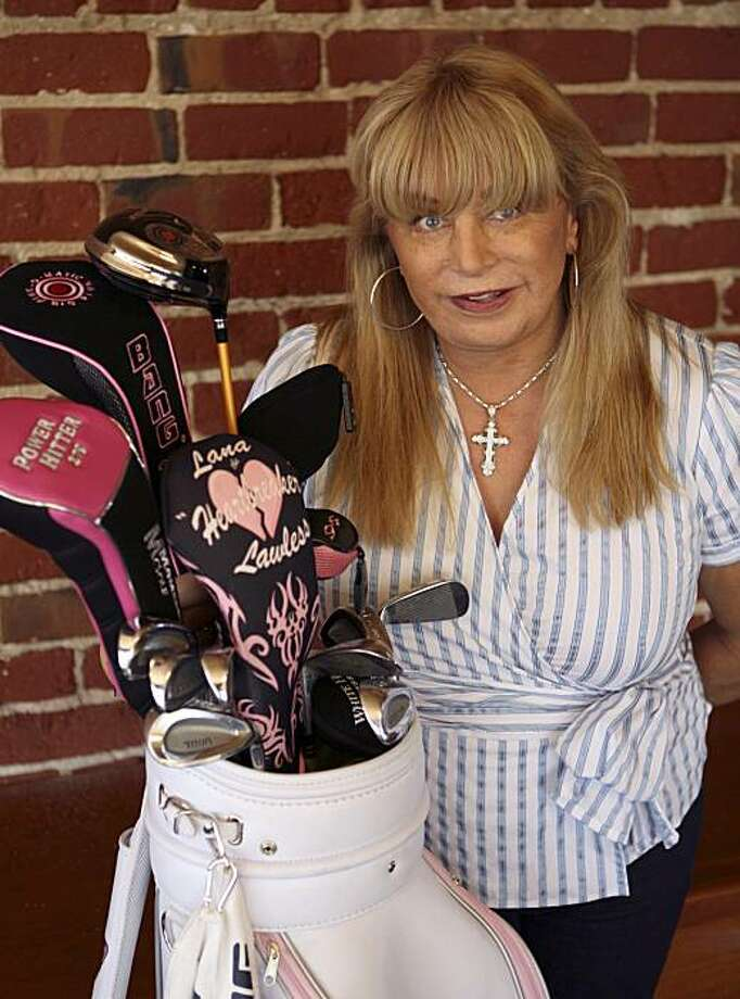 """Lana Lawless is photographed with her golf clubs Wednesday, Oct. 13, 2010, in San Francisco. Lawless, a former police officer who underwent a sex change operation five years ago, is challenging the LPGA's ban on transgender players.  She filed a federal lawsuit late Tuesday in San Francisco federal court claiming the LPGA's """"female at birth"""" requirement for competitors violates a California civil rights law. Lawless is seeking to prevent the LPGA from holding tournaments in the state until the organization changes its policy to admit transgender players. She is also seeking unspecified damages. Photo: Ben Margot, AP"""