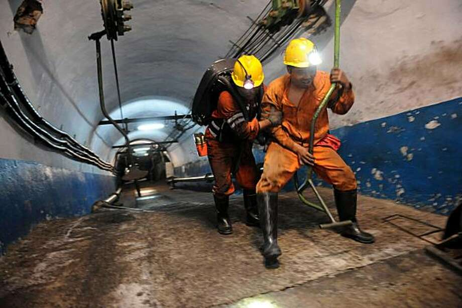 **CORRECTS CAPTION TO REMOVE REFERENCE TO NUMBER OF MINERS TRAPPED AND KILLED** In this photo distributed by China's Xinhua news agency, rescuers rescuers are ready to go underground after an explosion at the state-run Pingyu Coal & Electric Co. Ltd minein Yuzhou city, central China's Henan province, on Saturday Oct. 16, 2010. Rescuers battled dangerous levels of gas, tons of coal dust and the risk of falling rocks as they worked to free miners after the explosion at the mine in central China early Saturday. Photo: Zhu Xiang, AP