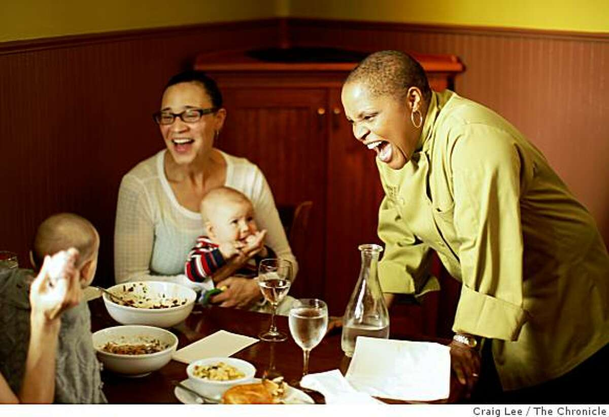 Tanya Holland chef and owner of Brown Sugar Kitchen, visiting with Stefanie Parrott and her 4 month-old son, Clyde (middle) and Rivkah Medow (just out the picture) and her 6 month-old son, Isa, in Oakland, Calif., on February 11, 2009.