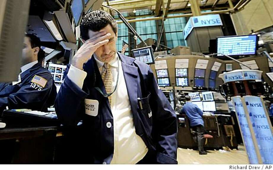 Specialist Peter Mazza works at his post on the floor of the New York Stock Exchange, Monday, Feb. 23, 2009. Investors unable to extinguish their worries about a recession that has no end in sight dumped stocks again Monday. The Dow Jones industrial average tumbled 251 points to its lowest close since Oct. 28, 1997, while the Standard & Poor's 500 index logged its lowest finish since April 11, 1997. (AP Photo/Richard Drew) Photo: Richard Drew, AP