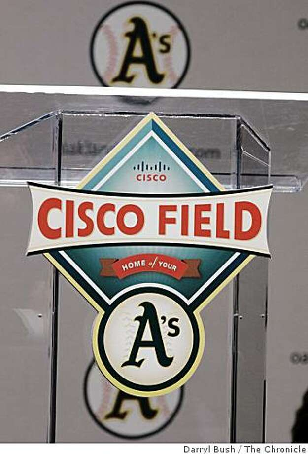 athletics14_018_db.JPG The new Cisco Field logo for the Oakland Athletics is unveiled at a press conference podium, for team to be moved to Fremont, Oakland Athletics press conference at Cisco Systems in (cq) in San Jose, CA, on Tuesday, November, 14, 2006. 11/14/06 Darryl Bush / The Chronicle ** Lew Wolf, John Chambers, Allan H. (Bud) Selig, Michael Crowley (cq) (cq) Photo: Darryl Bush, The Chronicle