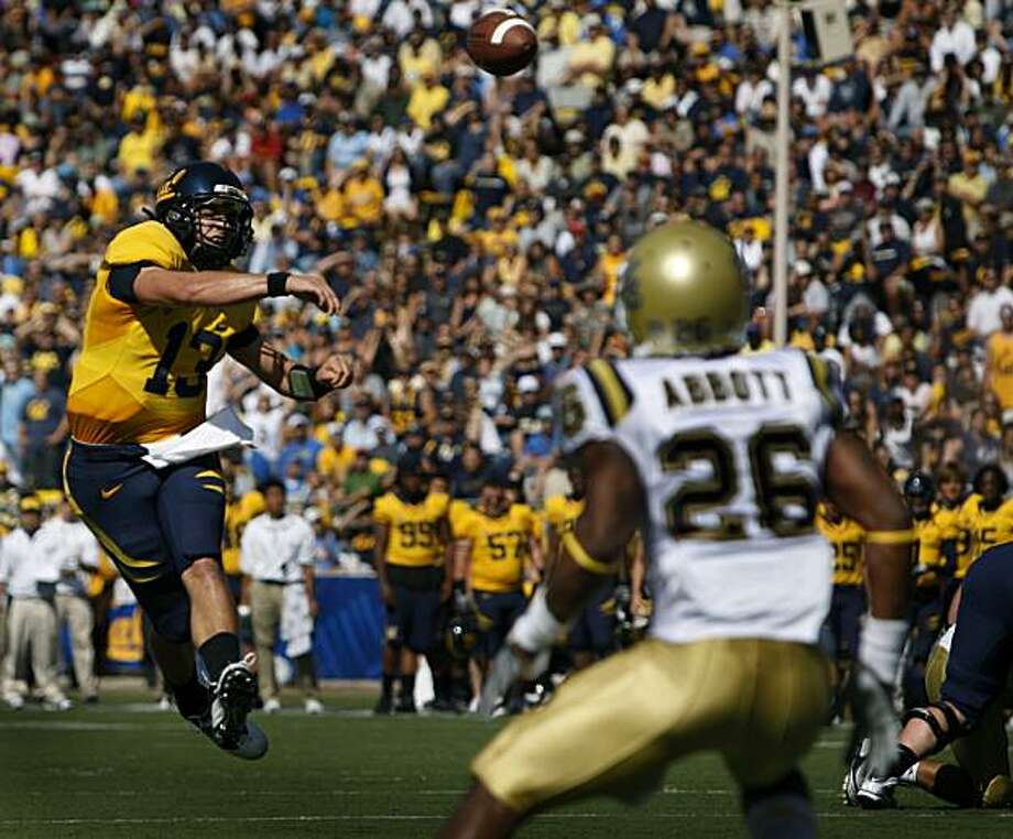 Kevin Riley tosses a touchdown pass to Keenan Allen in the second quarter of Cal's game against UCLA at Memorial Stadium in Berkeley on Saturday. Photo: Paul Chinn, The Chronicle
