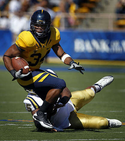 Shane Vereen picks up a first down after a pass reception in the second quarter of Cal's game against UCLA at Memorial Stadium in Berkeley on Saturday. Photo: Paul Chinn, The Chronicle