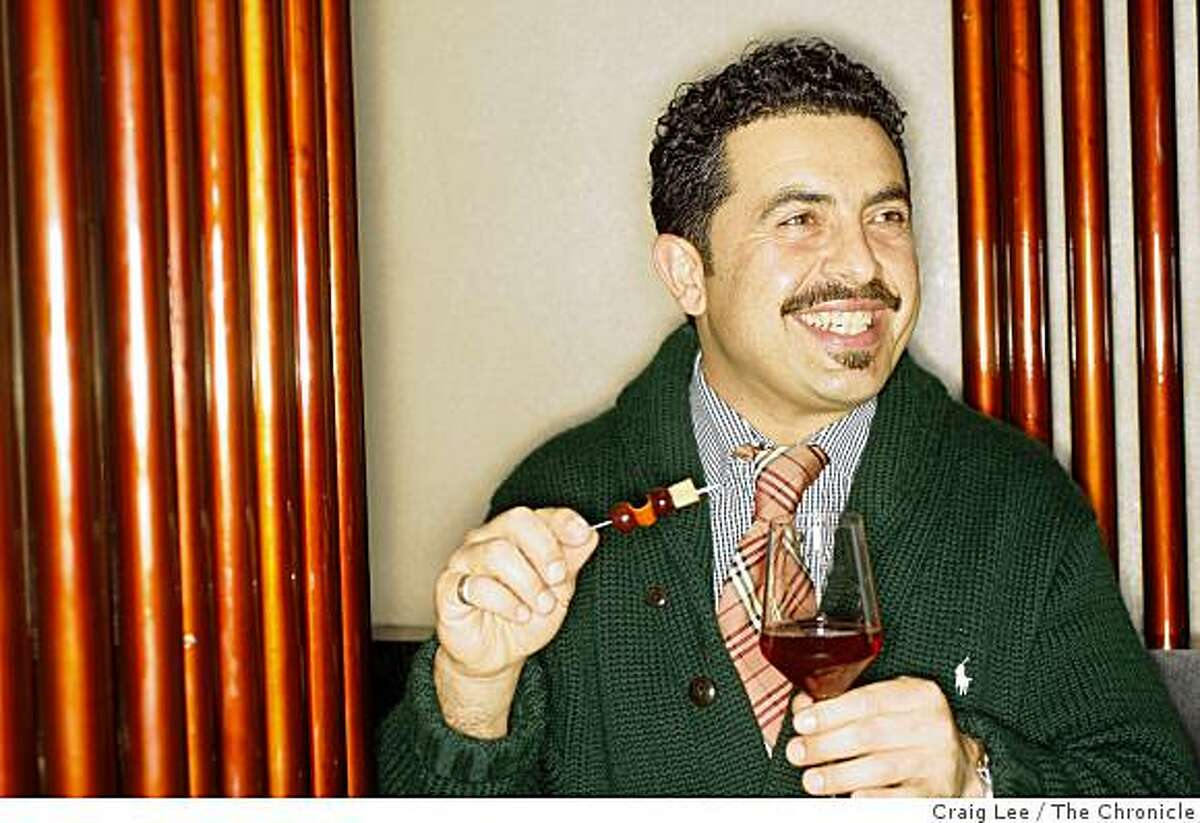 Reza Esmaili, consultant and bar manager with his drink, Noble Harvest at Conduit restaurant in San Francisco, Calif., on February 13, 2009.