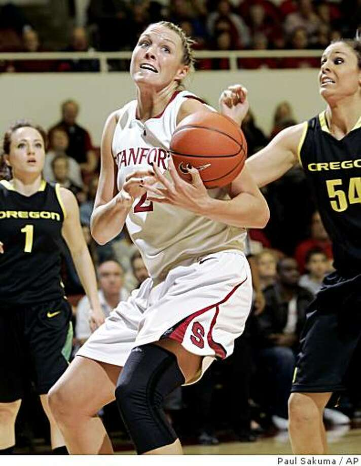 Stanford center Jayne Appel (2) loses the ball in front of Oregon forward Nicole Canepa (54) in the first half of an NCAA college basketball game in Stanford, Calif., Saturday, Feb. 21, 2009. (AP Photo/Paul Sakuma) Photo: Paul Sakuma, AP
