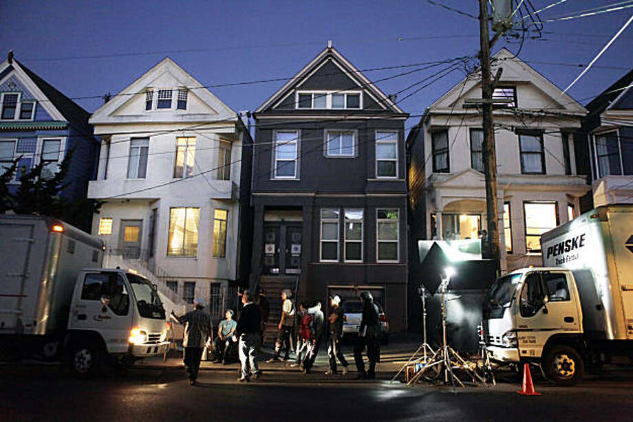A film production company works on Cole Street in San Francisco, Calif., on Wednesday, October 13, 2010. The project, a Japanese TV series, was doing a quick shoot in one of the houses, but even this quick shoot was a boost to local merchants, union drivers, electricians, restaurants and hotels as money from the production always goes into the local economy. Photo: Carlos Avila Gonzalez, The Chronicle