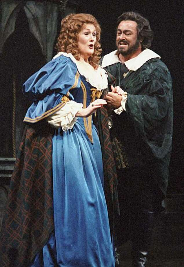 In this Friday, Jan. 10, 1987 file picture, Dame Joan Sutherland, left, and Luciano Pavarotti sing a scene from Gaetano Donizetti's opera Lucia di Lammermoor at the Metropolitan Opera in New York. Sutherland, a former small town secretarial schoolstudent whose mastery of tone, astonishing range and vocal control vaulted her into the top echelons of opera, died Sunday, Oct. 10, 2010 at 83. Photo: Osamu Honda, AP