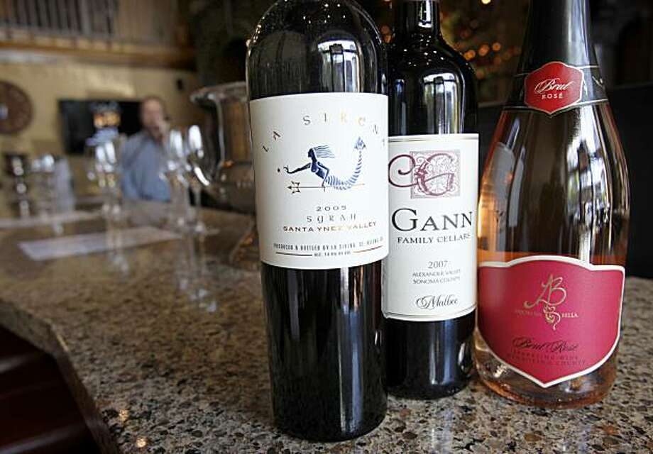 Three of the favorite wines at Cellars of Sonoma include a La Sirena Syrah (left), a Malbec from Gann family cellars (center) and Ambrosa Bella sparking wine. Photo: Brant Ward, The Chronicle