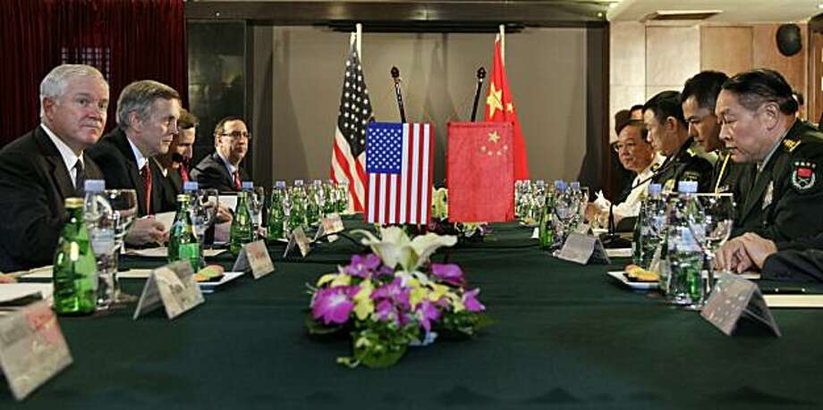 HANOI, VIETNAM - OCTOBER 11: US Defense Secretary Robert Gates (L) with China's Minister of Defense Liang Guanglie on October 11, 2010 in Hanoi, Vietnam. Gates is in the region to attend a meeting of defense ministers from around the Asia-Pacific region. Photo: Pool, Getty Images