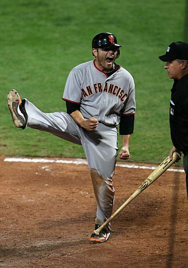 ATLANTA - OCTOBER 10:  Freddy Sanchez #21 of the San Francisco Giants celebrates after scoring during the 9th inning of Game Three of the NLDS of the 2010 MLB Playoffs making the score 3-2 on October 10, 2010 at Turner Field in Atlanta, Georgia. Photo: Jamie Squire, Getty Images