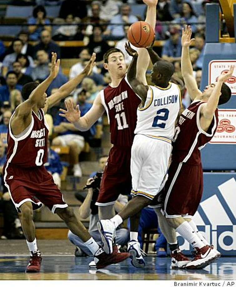 UCLA's Darren Collison (2) shoots a basket while being guarded by Washington State's Marcus Capers, left, Aron Baynes (11) and Taylor Rochstie, right,  during the first half of their NCAA college basketball game Saturday, Feb. 21, 2009, in Los Angeles. (AP Photo/Branimir Kvartuc) Photo: Branimir Kvartuc, AP