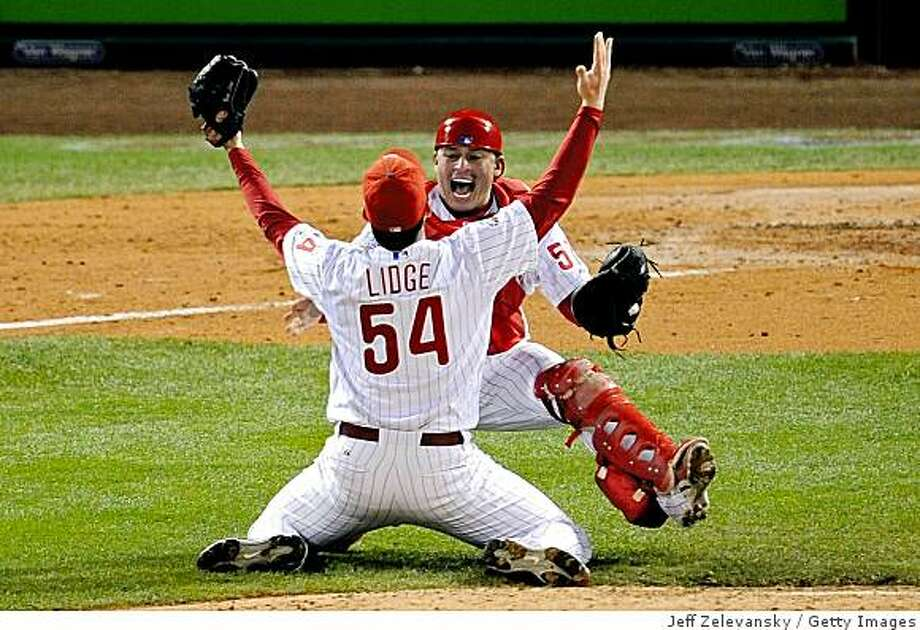 PHILADELPHIA - OCTOBER 29:  Catcher Carlos Ruiz #51 and Brad Lidge #54 of the Philadelphia Phillies celebrate after recording the final out of their 4-3 win to win the World Series against the Tampa Bay Rays during the continuation of game five of the 2008 MLB World Series on October 29, 2008 at Citizens Bank Park in Philadelphia, Pennsylvania.  (Photo by Jeff Zelevansky/Getty Images) Photo: Jeff Zelevansky, Getty Images