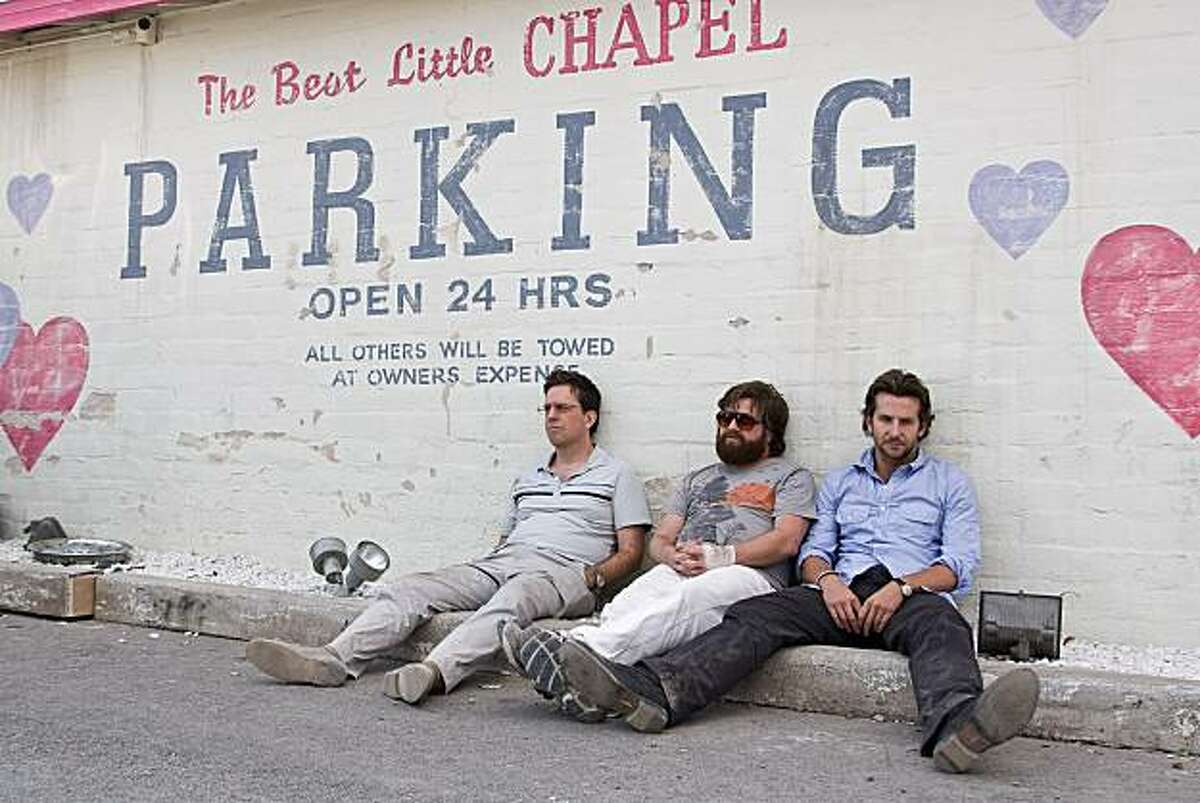 (L-r) ED HELMS as Stu, ZACH GALIFIANAKIS as Alan and BRADLEY COOPER as Phil in Warner Bros. Pictures' and Legendary Pictures' comedy
