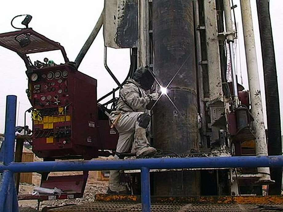 In this still image taken from a video released by the government of Chile on Oct. 10, 2010, steel pipes are welded as rescue efforts continue to free the 33 trapped miners at the San Jose mine near Copiapo, Chile, Sunday, Oct. 10, 2010. Saturday the drilling rig punched through to the collapsed mine where 33 miners have been trapped since Aug. 5. Photo: Government Of Chile, AP