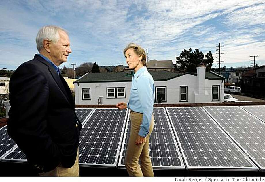 Homeowner Jeanne Pimentel discusses her solar installation with Berkeley Mayor Tom Bates on Friday, Feb. 27, 2009, in Berkeley, Calif. Pimentel purchased a 2KW solar array which provides about 7 KW hours per day on average. Photo: Noah Berger, Special To The Chronicle