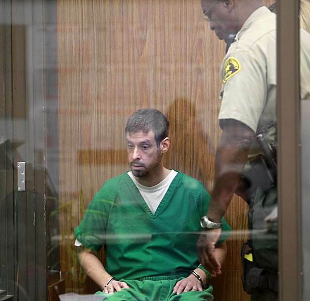 Brendan Liam O'Rourke is seated in the holding box in a San Diego Superior Courtroom where he was arraigned on charges stemming from an incident at the Kelly Elementary School in Carlsbad, Calif. where Orourke allegedly opened fire with a hand gun, wounding two elementary school students Wednesday, Oct. 13, 2010, in Vista.