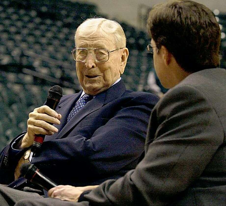 Indiana native and legendary former UCLA head coach John Wooden, left, answers questions from Bob Costas before the start of the second annual John R. Wooden Tradition Saturday, Nov. 24, 2001, in Indianapolis. (AP Photo/Darron Cummings) Photo: Darron Cummings, AP