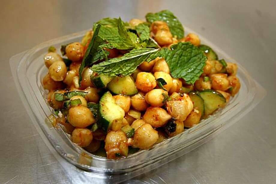 A garbanzo bean salad is typical of the handmade salads featured on a daily basis. Pal's Take Away is located inside Tony's Market at the end of 24th Street near Potrero. Photo: Brant Ward, The Chronicle