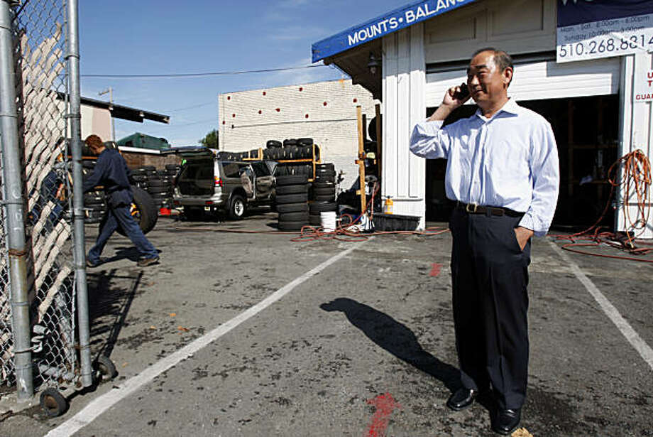 Property owner Sang Hahn stands in West Oakland Tires and Repairs, a business that would have to close if the property would be sold to the city in Oakland, Calif., on Sept. 08, 2010. Photo: Michelle Gachet, The Chronicle