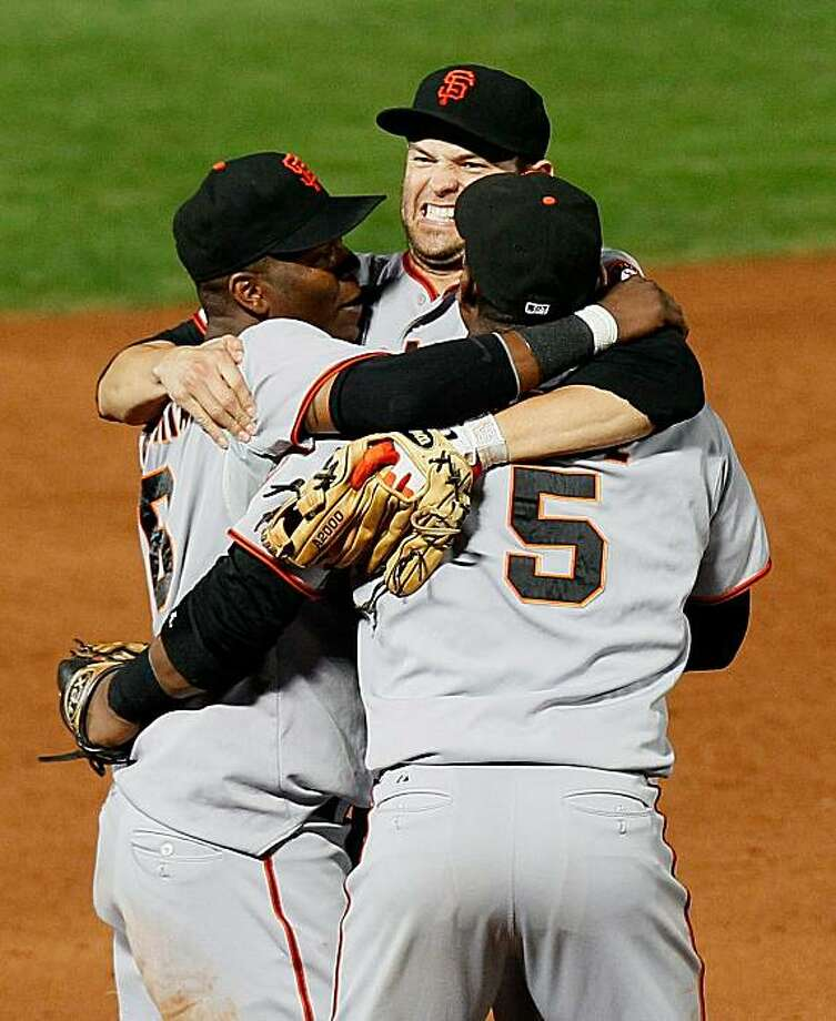 ATLANTA - OCTOBER 11:  Edgar Renteria #16, Freddy Sanchez #21 and Juan Uribe #5 of the San Francisco Giants celebrate after they defeated the Atlanta Braves 3-2 during Game Four of the NLDS of the 2010 MLB Playoffs at Turner Field on October 11, 2010 in Atlanta, Georgia. Photo: Kevin C. Cox, Getty Images