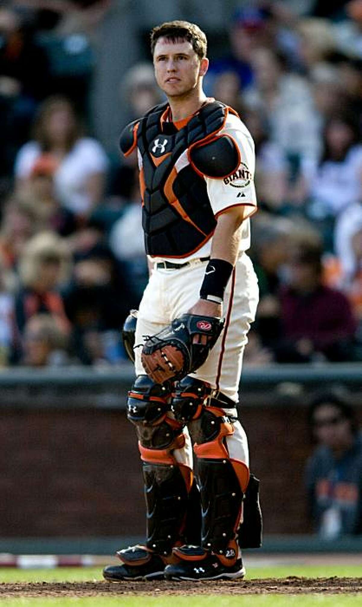 Buster Posey takes off his mask in between pitches as the San Francisco Giants take on the Milwaukee Brewers at AT&T Park in San Francisco, Calif., on Sunday, September 19, 2010.