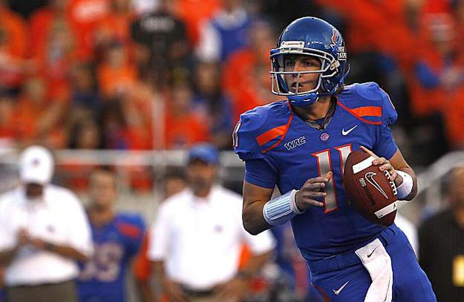 Boise State's Kellen Moore (11) looks downfield before throwing during the first half of an NCAA college football game on Saturday, Oct. 8, 2010 in Boise, Idaho. Photo: Matt Cilley, AP