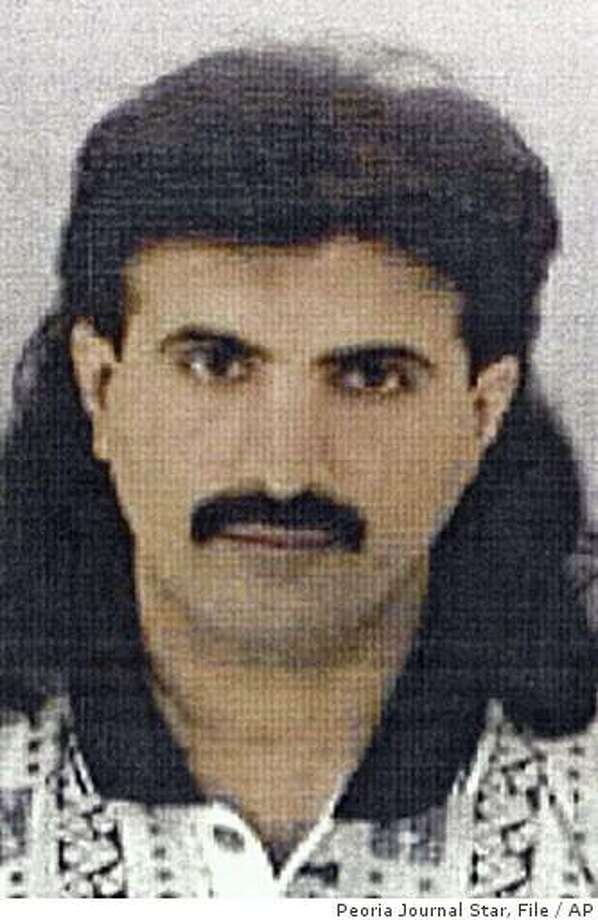 **FILE** Ali Saleh Kahlah Al-Marri, shown in an undated file photo, was designated Monday June 23, 2003, as an enemy combatant by President Bush. Federal prosecutors plan to move Al-Marri, a native of Qatar, and alleged al-Qaida sleeper agent out of a Navy brig in South Carolina and send him to federal court in Illinois to face trial. Two people familiar with the case of Qatar native Ali al-Marri said Thursday Feb. 26, 2009 the government plans to transfer him to the civilian court system. The two people spoke on condition of anonymity because no official announcement has been made. (AP Photo/Peoria Journal Star, File) Photo: Peoria Journal Star, File, AP