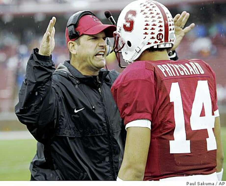 Stanford coach Jim Harbaugh, left, talks with quarterback Tavita Pritchard (14) in the first quarter of an NCAA college football game in Stanford, Calif., Saturday, Nov. 1, 2008. (AP Photo/Paul Sakuma) Photo: Paul Sakuma, AP