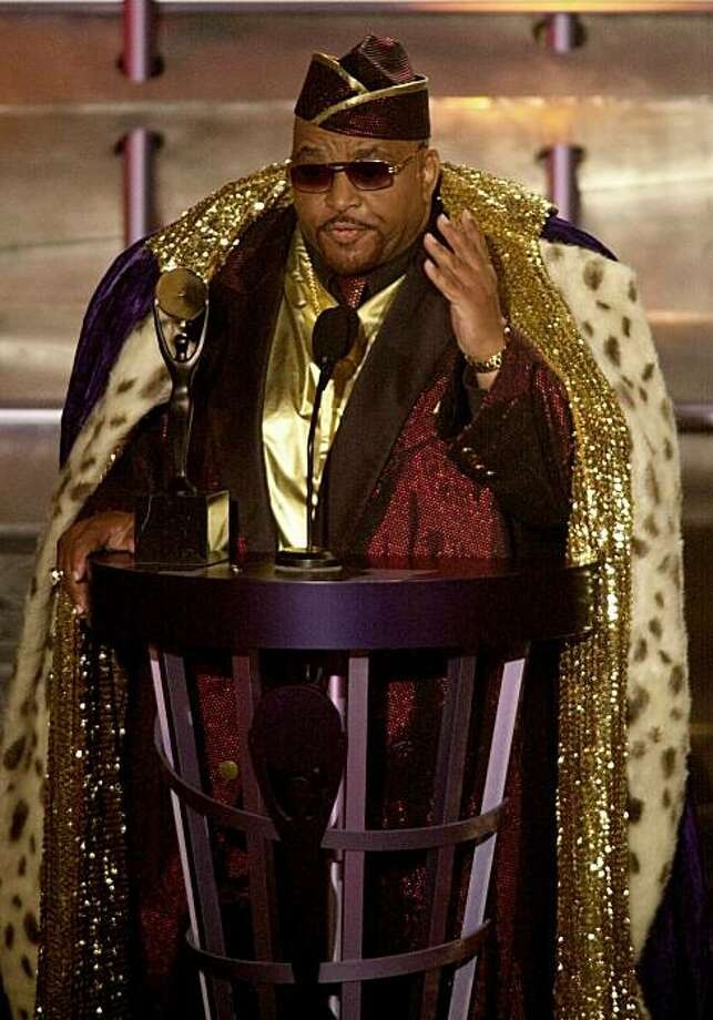 Solomon Burke, one of the pioneers of soul music, gestures to the audience after being inducted into the Rock and Roll Hall of Fame in this March 19, 2001 file photo taken in New York. Burke has died at Amsterdam's Schiphol Airport. Airport police spokesman Robert van Kapel confirmed the death of the singer Sunday Oct. 10, 2010. He was 70. Photo: Kathy Willens, AP