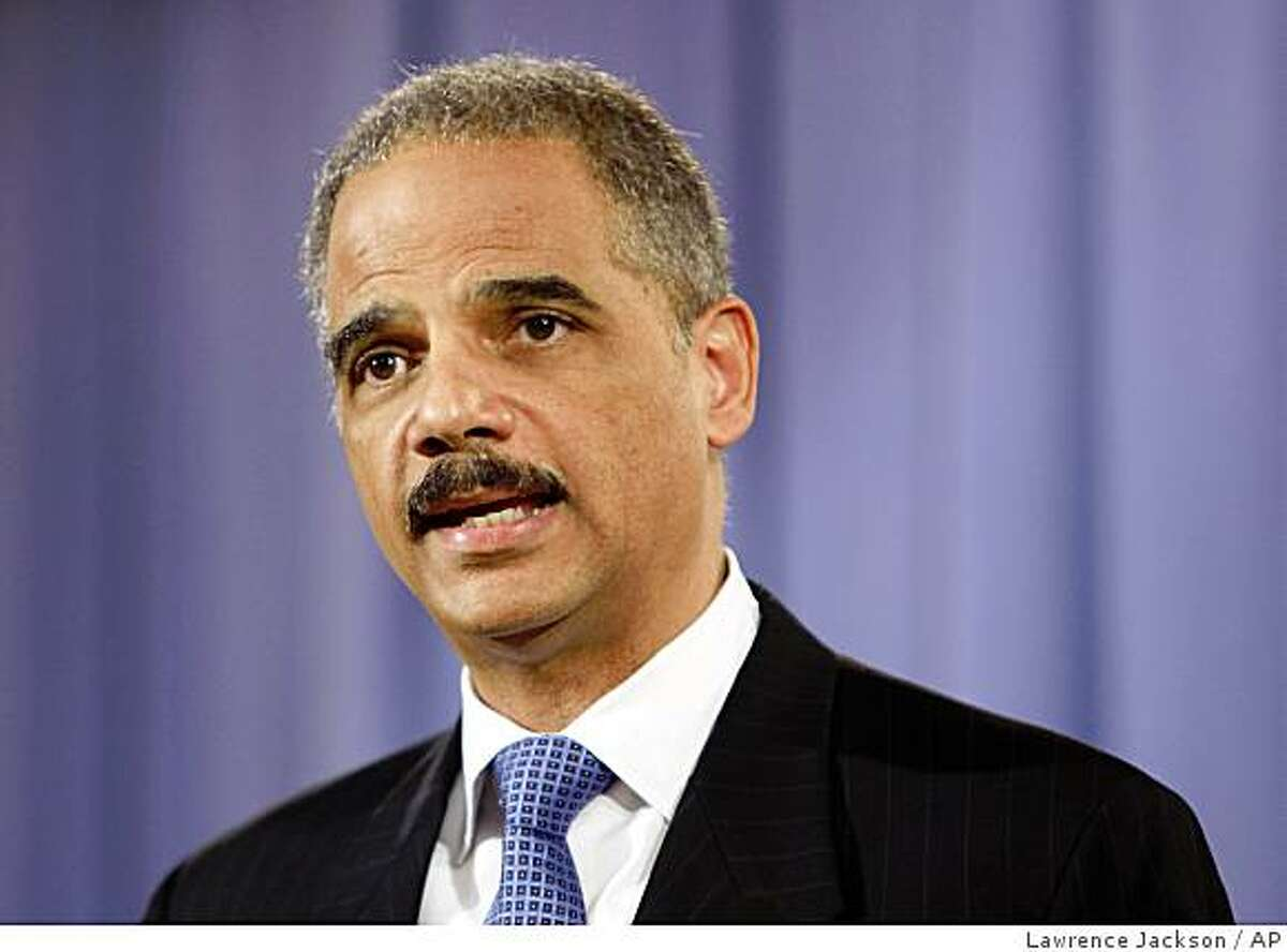 Attorney General Eric Holder addresses the media at the Justice Department in Washington, Wednesday, Feb. 25, 2009. (AP Photo/Lawrence Jackson)