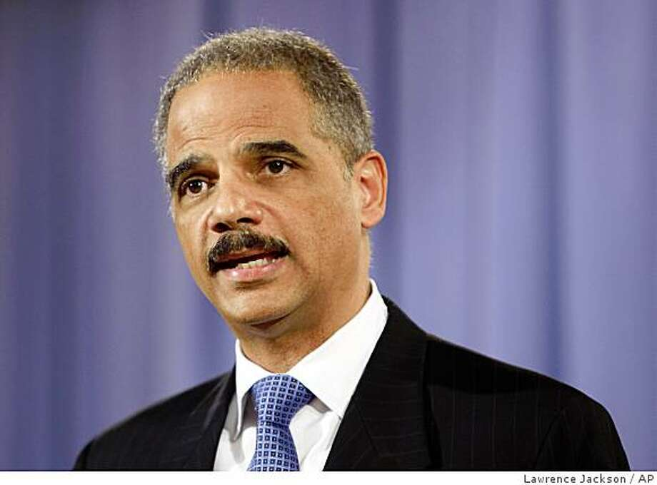Attorney General Eric Holder addresses the media at the Justice Department in Washington, Wednesday, Feb. 25, 2009. (AP Photo/Lawrence Jackson) Photo: Lawrence Jackson, AP
