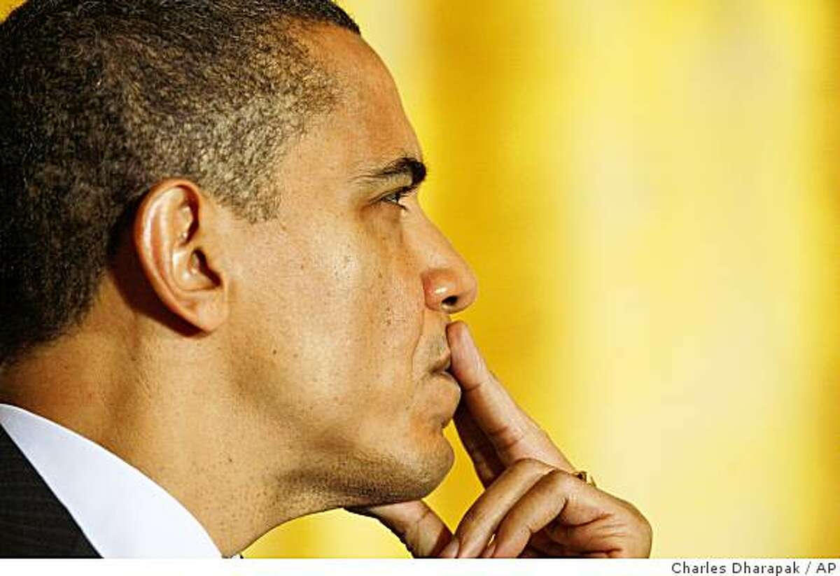 President Barack Obama is seen on stage in the East Room of the White House in Washington, Monday, Feb. 23, 2009, before he addressed lawmakers at the Fiscal Responsibility Summit. (AP Photo/Charles Dharapak)