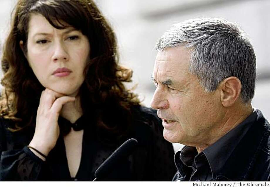 Melissa Nix, (left) ex-girlfriend of Hugues de la Plaza listens to Francois de la Plaza (right), the father of Hugues de la Plaza at a press conference on the steps of San Francisco city hall on Thursday, February 26, 2009.  They are seeking answers and accountability for the SFPD's investigation into their son's death. Photo: Michael Maloney, The Chronicle