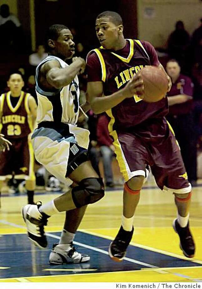 Lincoln's Deend Parker (right) is defended by Wallenberg's Travis Barabin as Wallenberg High beats Lincoln 58-54 in boys' varsity basketball action on Tueday, Jan. 27, 2009 at Kezar Pavilion in San Francisco. Photo: Kim Komenich, The Chronicle
