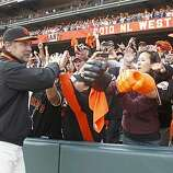 Giants manager Bruce Bochy celebrates the NL western division championship with fans at AT&T Park in San Francisco, Calif., on Sunday, Oct. 3, 2010.