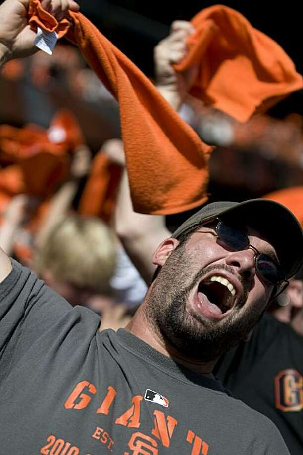 Jacob Castiglionia of Sebastapol goes wild as the Giants score two runs in the third inning against the San Diego Padres at AT&T Park on Sunday. Photo: Chad Ziemendorf, The Chronicle