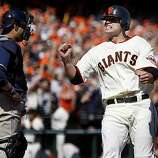 Freddie Sanchez reacts to scoring the Giants' second run in the third inning on a hit by Aubrey Huff on Sunday.