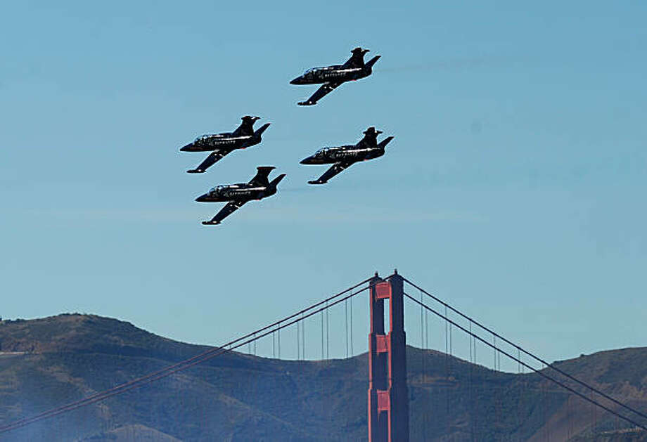 Members of the Patriot Jet Team pass the Golden Gate Bridge during Fleet Week celebrations on Saturday, Oct. 9, 2010, in San Francisco. Photo: Noah Berger, Special To The Chronicle