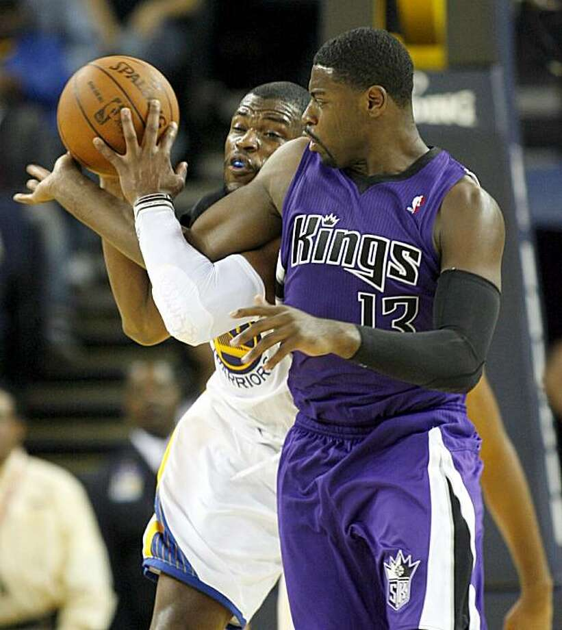 The Golden State Warriors' Jeff Adrien and the Sacramento Kings' Tyreke Evans (13) fight for a loose ball in the second half of an NBA preseason basketball game, Sunday, Oct. 10, 2010 in Oakland, Calif. Photo: Dino Vournas, AP
