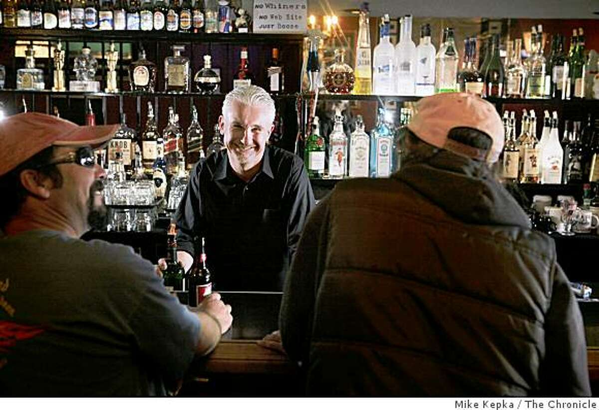 Ray Rex, owner The Hearth on Geary Street, stands behind his bar on Thursday Feb. 19, 2009 in San Francisco, Calif.