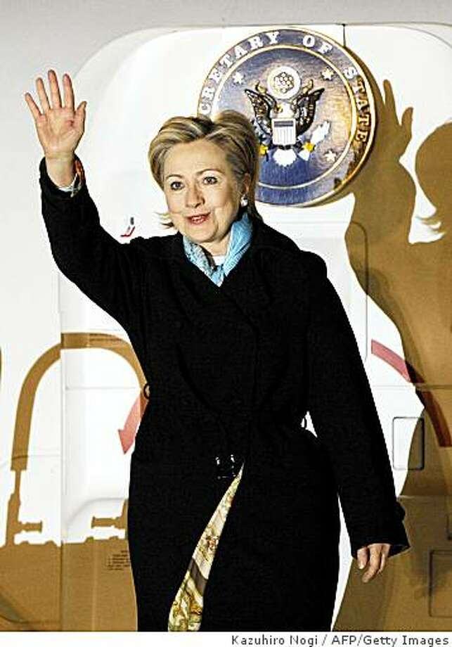 (FILES) This file photo taken on February 16, 2009 shows US Secretary of State Hillary Clinton arriving at Tokyo's Haneda Airport.  Clinton urged US military personnel in Japan on February 22, 2009, during a brief refueling stopover on her way back to the US, to be prepared at a time of uncertainty.   AFP PHOTO / Kazuhiro NOGI (Photo credit should read KAZUHIRO NOGI/AFP/Getty Images) Photo: Kazuhiro Nogi, AFP/Getty Images