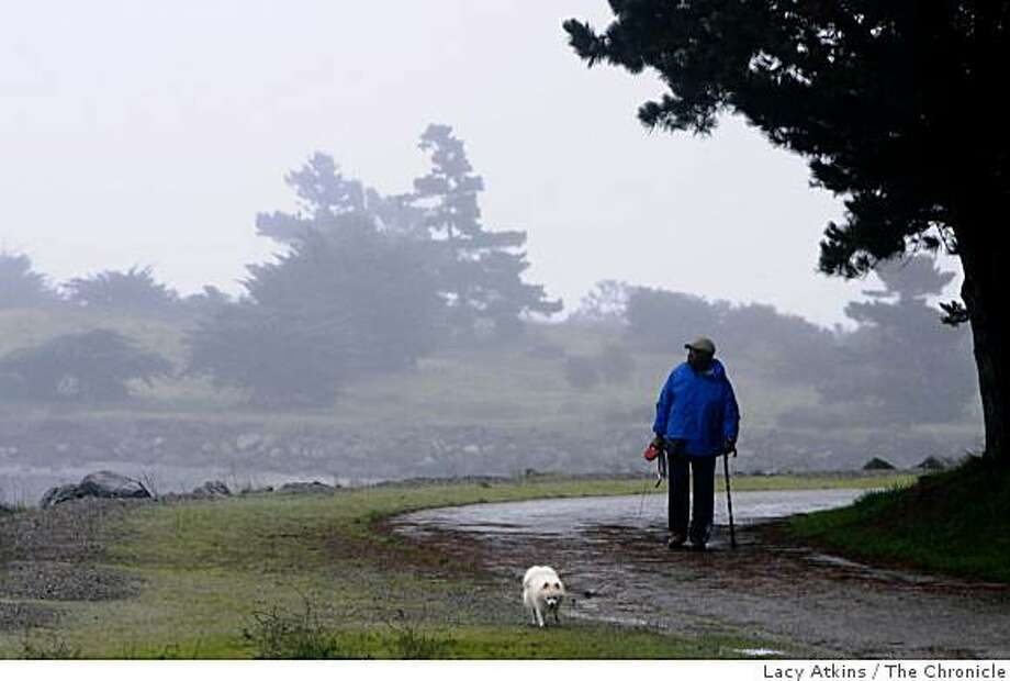 "Alfred Brown walks his dog ""Champ"" around Candlestick Point Park, Thursday January 10, 2008, in San Francisco, Ca.  He has walked this park for twenty years. This is one of the California parks that will be closed due to the latest rounds of budget cuts. (Lacy Atkins  San Francisco Chronicle) Photo: Lacy Atkins, The Chronicle"