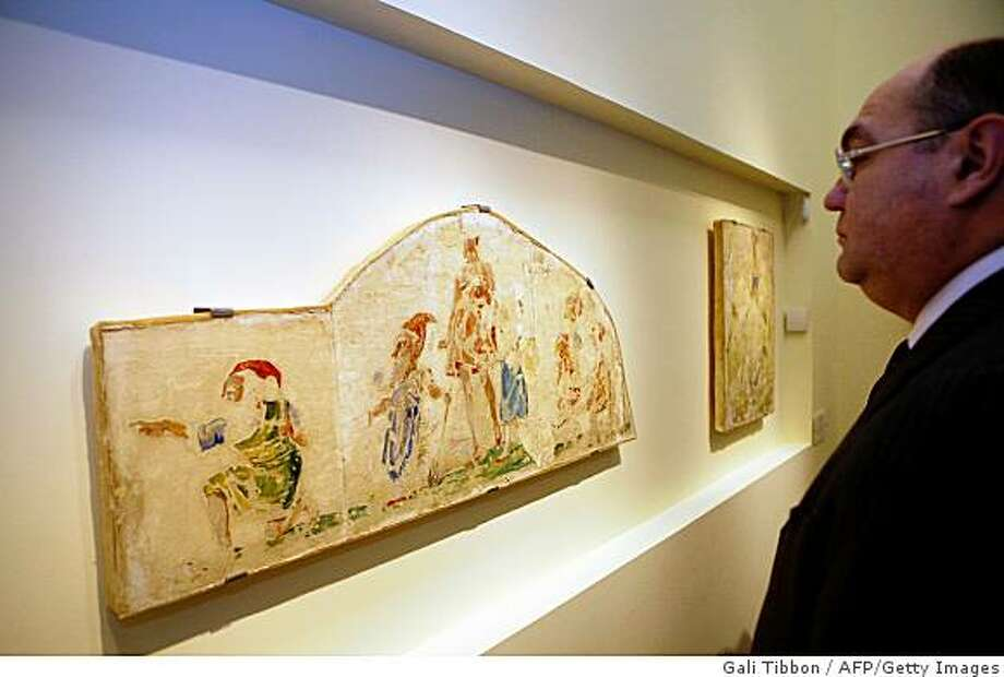 A man looks at wall paintings made by Jewish author and artist Bruno Schulz during the opening ceremony ?Bruno Schulz: Wall Painting under Coercion?, a new exhibition at the Yad Vashem Museum of Holocaust Art in Jerusalem on February 20, 2009.  The display includes three wall paintings, from the last known work by the Drohobycz-born Schulz before his murder on November 19, 1942 at the hands of German SS officer Karl Gunther, a rival of Felix Landau, who had ordered the murals for his home. Photo: Gali Tibbon, AFP/Getty Images