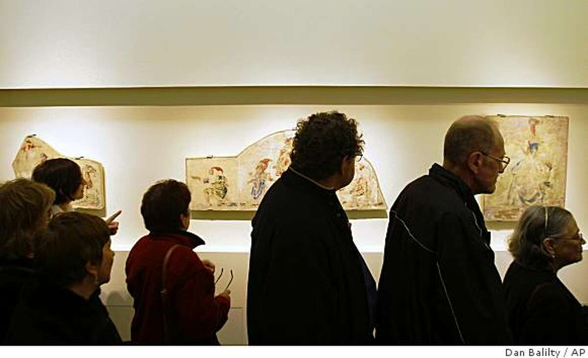 Israelis attend the exhibition of Jewish author and artist Bruno Schulz at the Yad Vashem Holocaust Memorial in Jerusalem, Friday, Feb. 20, 2009. Schulz, known as the
