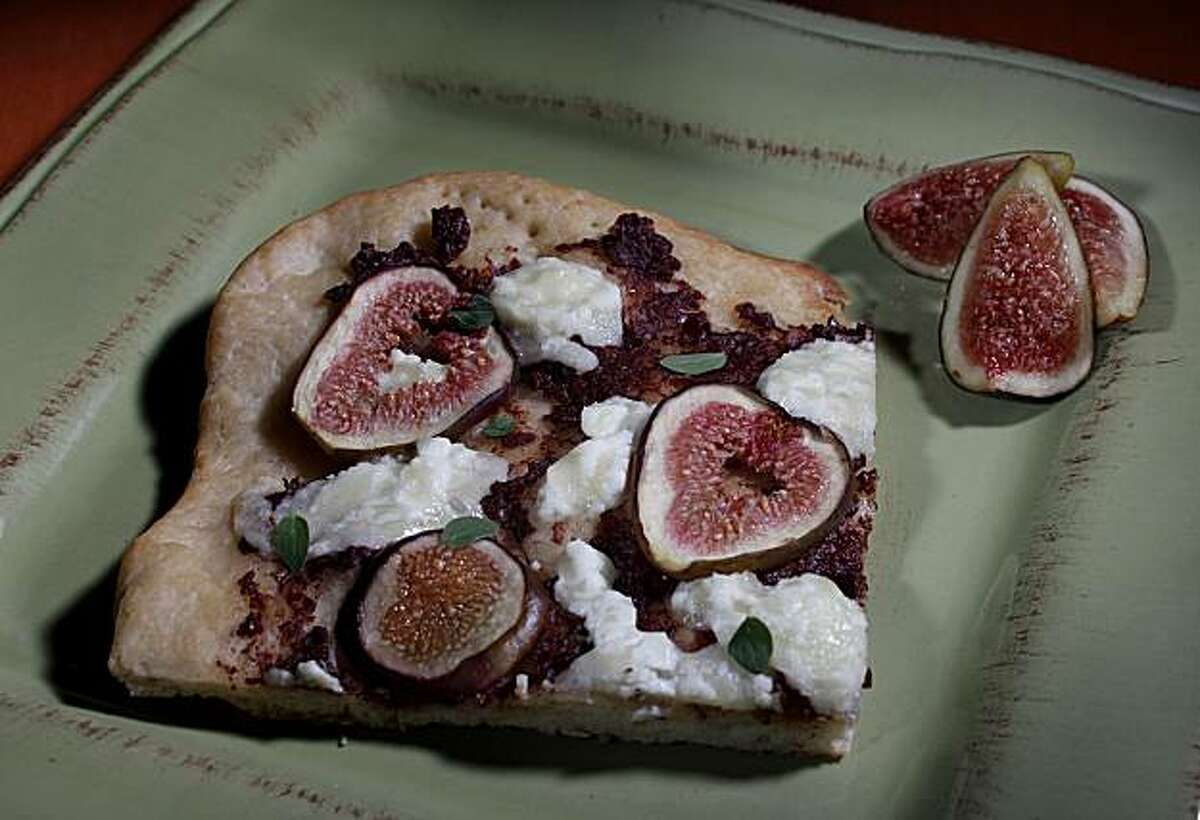 Fig, olive tapenade and goat cheese pizza sits on a plate, Wednesday, Oct. 6, 2010 in San Francisco, Calif.