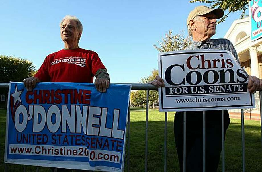 NEWARK, DE - OCTOBER 13: O'Donnell suppporter Bill Ward (L) and Coons Supporter Bob Baur (R) hold campaign signs in front of the debate hall at the University of Delaware on October 13, 2010 in Newark, Delaware. Republican Senate hopeful Christine O'Donnell and Democratic Senate hopeful Chris Coons are running for Vice President Joseph Biden	s old Senate seat and will both participate in tonights debate. Photo: Mark Wilson, Getty Images